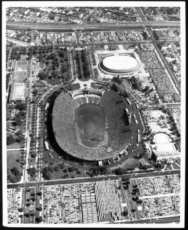 An aerial view of the Coliseum and Sports Arena, looking east