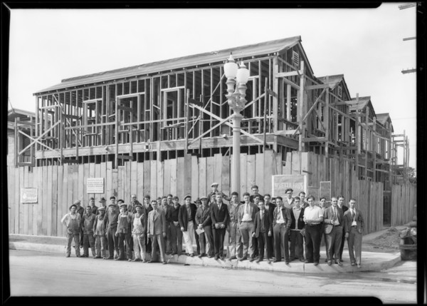 Boys inspecting frame house, Southern California, 1930
