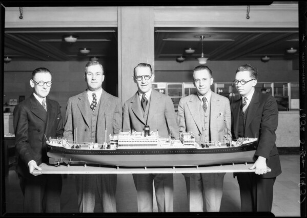 Group of men and model ship, foreign trade week, Southern California, 1928