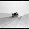 Studebaker making run on dry lake, Southern California, 1931