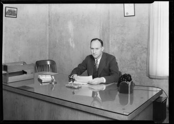 Mr. Christian at his desk, Pennzoil Co., Southern California, 1930