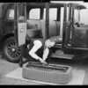 Putting seat covers on, rubber apron & covers etc., Southern California, 1930