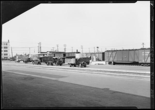 Unloading radios from train, Southern California, 1928