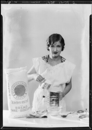 Gladys McConnell mixing dough, Southern California, 1928