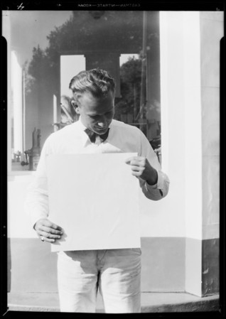 Man holding ad, Union Oil Co., Southern California, 1931