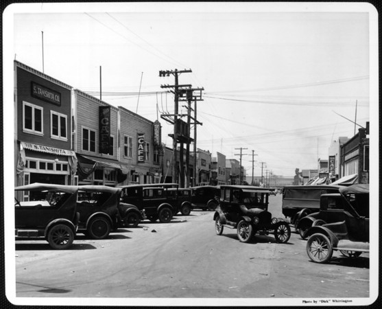 Cars parked in a row along Tuna Street which houses many fishing businesses