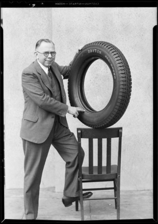 Salesman getting the 'dope' on new tire, Southern California, 1931
