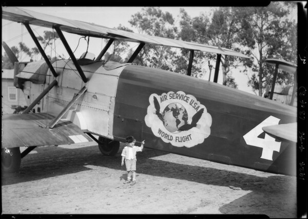 Edward in airplane & locomotive cab, Southern California, 1924