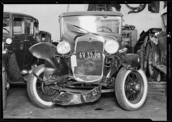 Wrecked Ford and Studebaker, Southern California, 1931