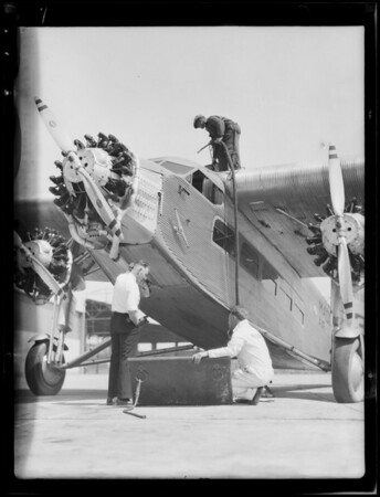 3/4 view plane for Clarkson Dye, artist also loading gas in plane, Southern California, 1929