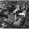 An aerial view of the Los Angeles Civic Center, looking east with the Department of Water and Power building and unfinished Music Center in the foreground