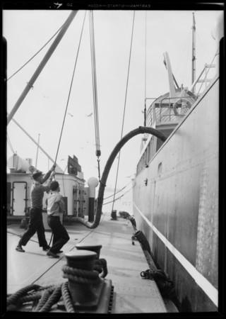 Loading oil at San Pedro, engine on street (Diesel), Union Oil, San Pedro, Los Angeles, CA, 1931