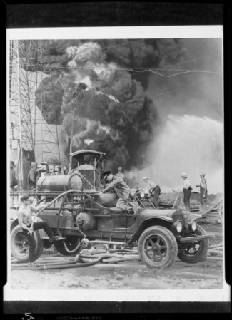 Composites of truck and oil well fire, Southern California, 1929