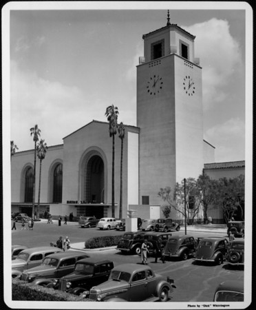 Union Station as seen from its parking lot, with people walking to their cars