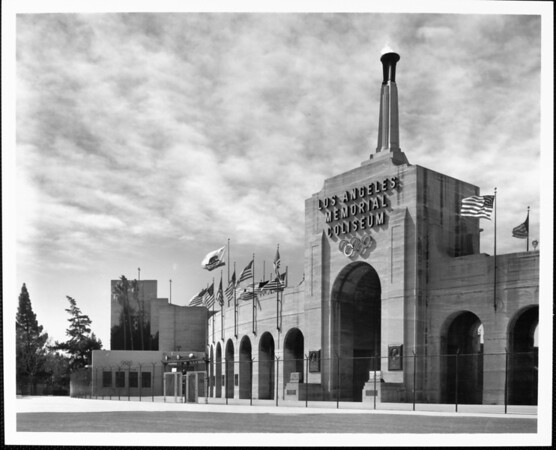 A low-angle view of the entrance of the Los Angeles Memorial Coliseum
