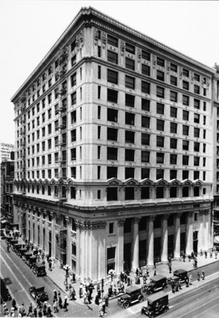 A high-angle view of the Pacific Southwest Trust and Savings Bank as people crowd along the sidewalk, Los Angeles, ca.1936-1940