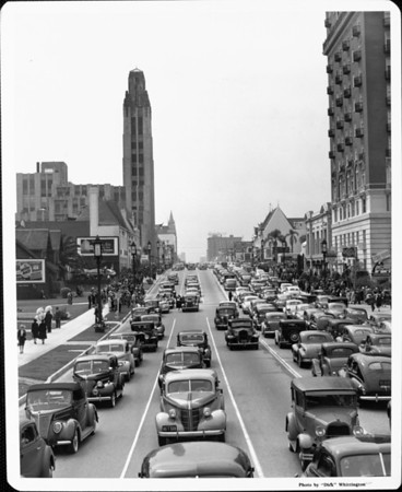 A traffic jam along Wilshire Boulevard and pedestrians also crowd the sidewalk