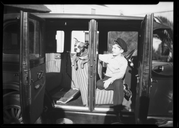 Edward and dog in car, Southern California, 1930