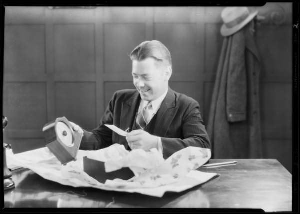 Businessman receives barometer for Christmas, Southern California, 1929