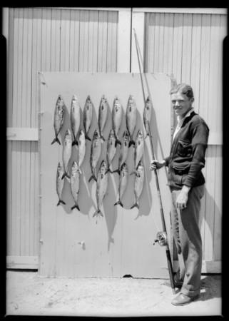 Fish on garage door, Southern California, 1925
