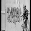 Fish on garage door, Southern California, 1925
