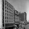 A view of the Parmelee Dohrmann Company along Flower Street