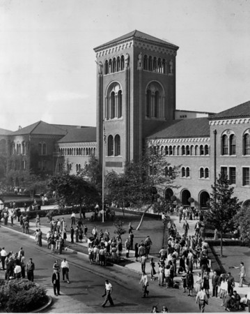 A high-angle view of many students crowded in front of the Bovard Auditorium in the University of Southern California (USC)