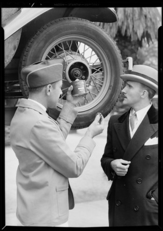 Young man watching greasing of car, Union Oil Co., Southern California, 1931