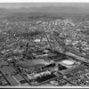 An aerial view looking northeast over the Coliseum toward downtown Los Angeles