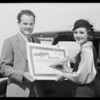 Mary Astor and Frank Muller signing gold bond, Southern California, 1931
