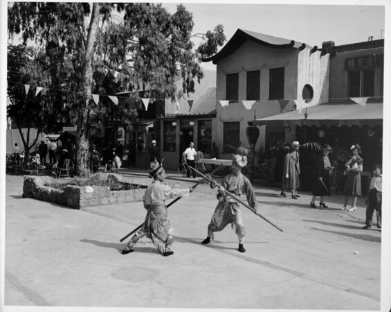 Two men fighting with sticks in a square, Chinatown-1939