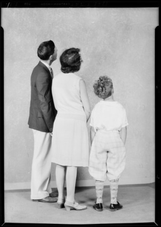 Backs of people for composite with large radio, Southern California, 1929