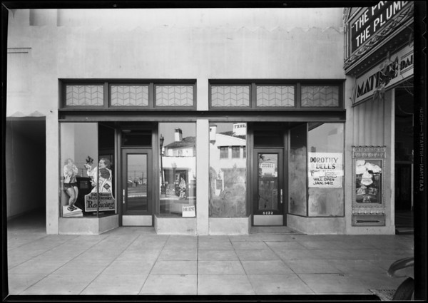 Signs etc. in store windows, Wilshire theatre building, Southern California, 1931
