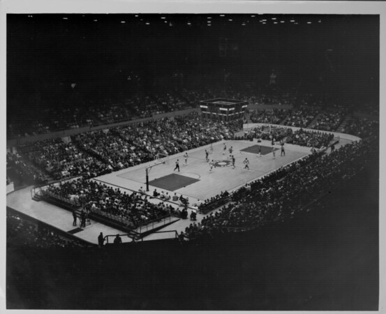 Interior view of Los Angeles Memorial Sports Arena from the colonnade seats showing a basketball game between the Los Angeles Lakers and Boston Celtics is in progress