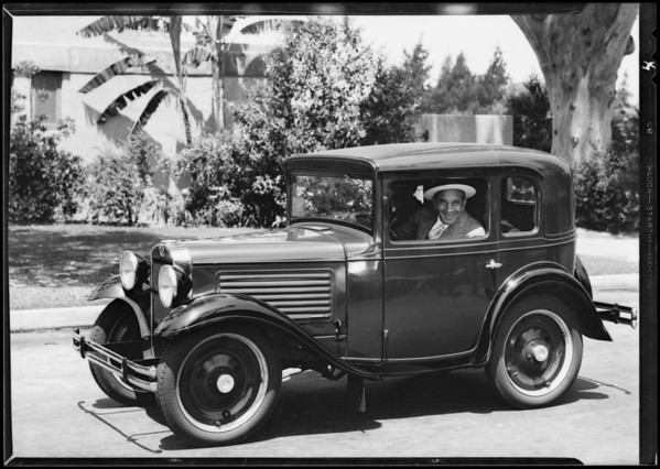 Al Jolson with Austin car, Southern California, 1930