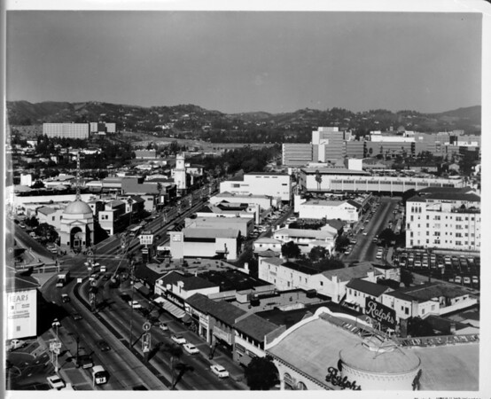 Aerial view facing north up Westwood Boulevard over Ralph's Grocery, Bank of America, Kirk Drug, and other shops