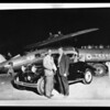 Composite of Mark Hanna, Hollywood Dodge dealer, and Captain Frank Hawks, the night he arrived from New York, Metropolitan Airport [Van Nuys Airport], Los Angeles, CA, 1929