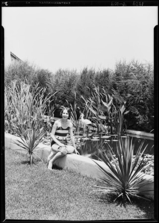 Photograph of Margaret Hoffman by bathing pool, Southern California, 1929