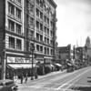 Main Street looking north from Fourth Street, Boyd's Custom Bilt Shoes, Hotel Barclay, Follies Theatre, Higgins Building, City Hall