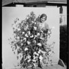 Marilyn Marsh and cotton plant, Southern California, 1929