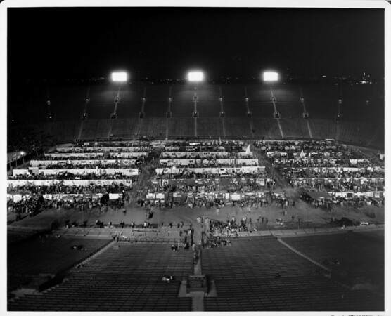 An exhibition taking place at night in the Coliseum at Exposition Park