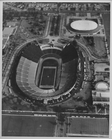 Aerial photo facing east over the Coliseum and Sports Arena in Exposition Park