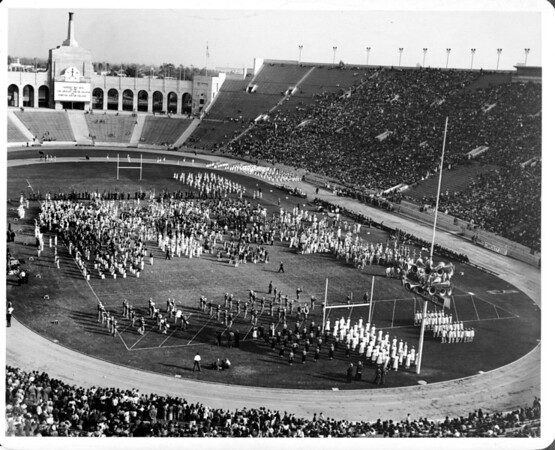 Parades, crowds at the Coliseum in Exposition Park, marching band competition
