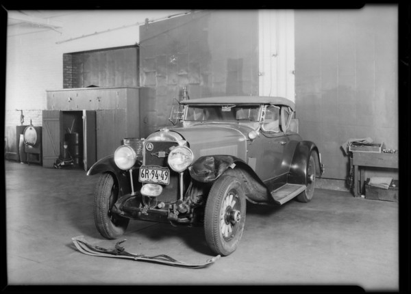 Wrecked Buick in Howard Automobile Co. garage, Southern California, 1930
