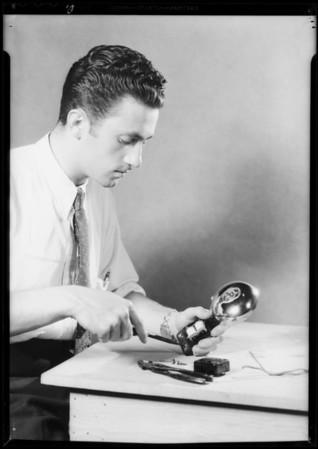 Repairing electrical parts, Logan & Stebbins, Southern California, 1931