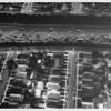 Aerial view on residential community adjacent to freeway