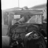 Triplex glass in wrecked Ford at Merney's Garage, Southern California, 1929