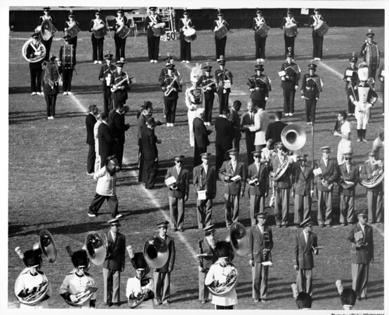 Ceremony featuring the University of California at Los Angeles (UCLA) (and University of California at Santa Barbara (UCSBC)) Marching Band at the Coliseum at Exposition Park