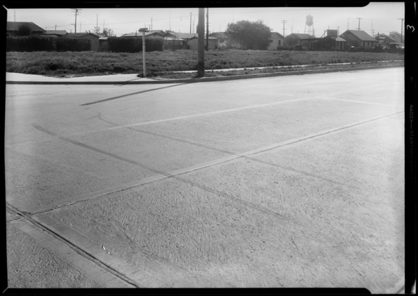 Skid marks at East 92nd Street and South Main Street with Mr. Weigel, Los Angeles, CA, 1931