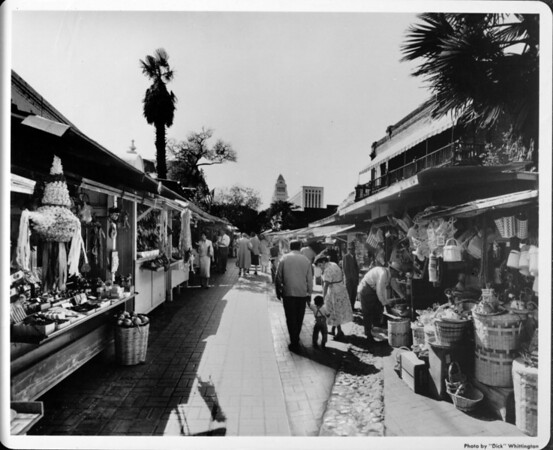 Olvera Street facing towards City Hall, shoppers, kiosks